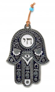 Hamsa hand amulet isolated on white